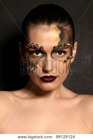 Woman With Dark  Hair And Bright Extraordinary Makeup