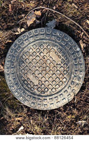 Sewer Manhole Cover In The Park Ground