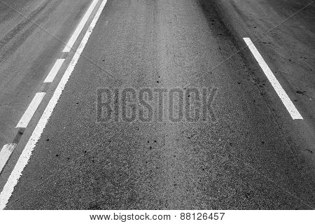 Asphalt Road With Dividing Lines And Perspective Effect