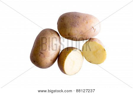 Still Life Of Golden Potatoes On White Background