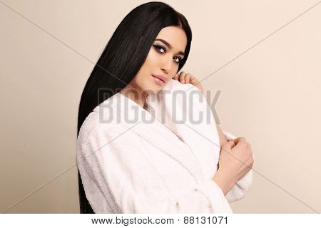 Sensual Woman With Dark Hair And Bright Makeup,wearing White Cozy Bathrobe