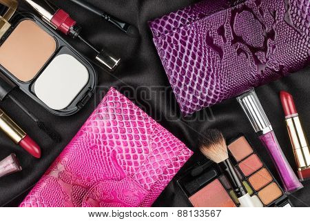 Beautiful Pink And Lilac Bags Among Cosmetics