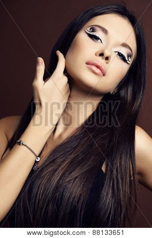 Young Woman With Dark  Hair And Bright Extraordinary Makeup