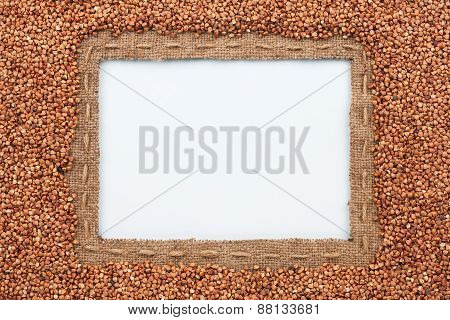 Frame Made Of Burlap With The Line And Buckwheat  Grain  Lies On White Background