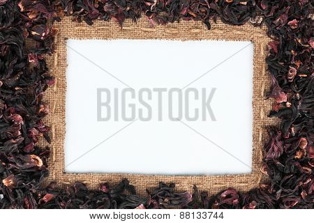 Frame Made Of Burlap With The Line And  Hibiscus  Lies On White Background
