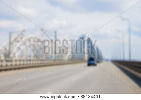 Blurred Car Driving To The Horizon