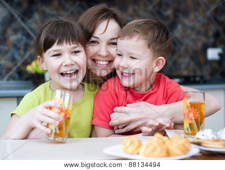 Mother With Children Drink Juice