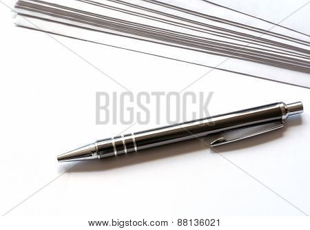 blank letterhead and a pen
