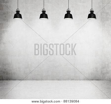 Concrete Room With Four Black Lamps.