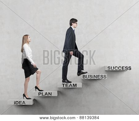 A Couple Is Going Up. A Concept Of The Successful Business Team Is Making Efforts At The Career Stai