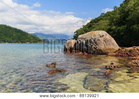 Transparent Water And Stones In Sea Near Beach Cotia On Island Near Paraty, Brazil