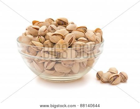 Pistachio Nuts In A Glass Bowl On White With Clipping Path, Side View