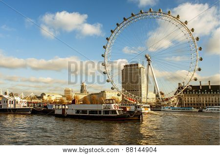 LONDON, UNITED KINGDOM - JANUARY 19: The River Thames and the London Eye on January 19, 2015 in London, United Kingdom. It is the tallest Ferris wheel in Europe with 135 meters high