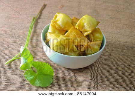 A Bowl Of Fried Dumplings Wrapped Quail Eggs