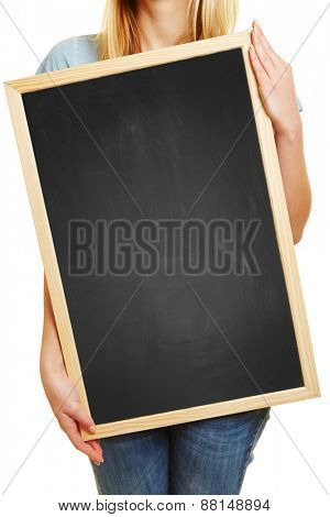 Blonde woman holding empty black chalkboard in her hands