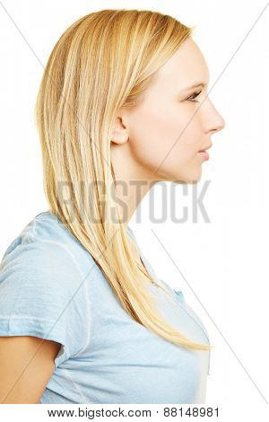 Profile of young blonde woman in side view