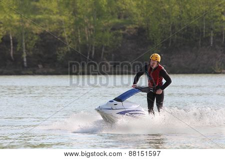 A man turn on the jet ski.