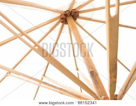 Under View Of White Umbrella With Wood Splines