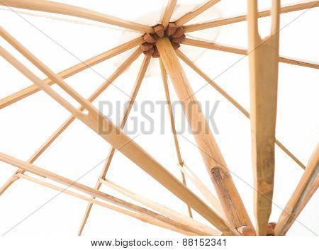 Under View Of White Umbrella With Wood Splines