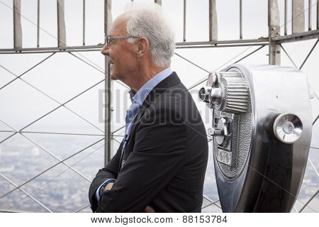 NEW YORK - APRIL 17, 2015: Soccer legend Franz Beckenbauer from the New York Cosmos on the observation deck of the Empire State Building to launch and celebrate the start of the 2015 season.