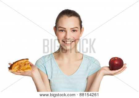 Young smiling woman with a piece of pizza and apple, isolated on white