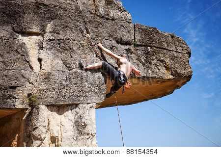 Male rock climber on a cliff