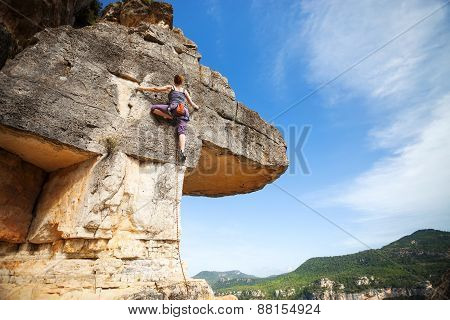 Woman climber on a cliff