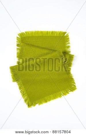 green place mat with fringe on white background