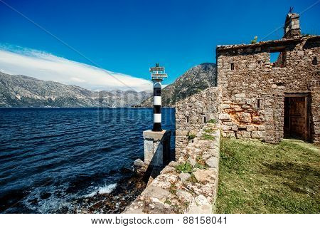 Old church and lighthouse in Kotor bay