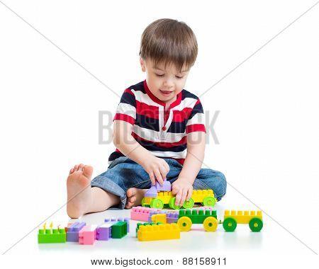 Portrait of little boy with toy blocks