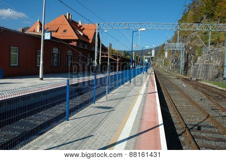 Platform And Railway Tracks On Railway Station.