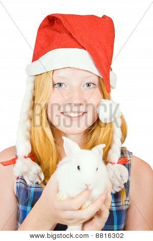 Girl In Santa Hat With Rabbit