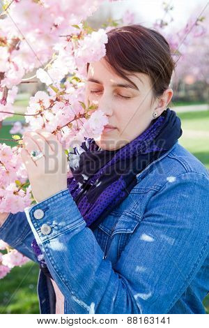 Woman Smelling At Almond Tree No Hay Fever.