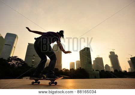 skateboarder skateboarding at sunrise city
