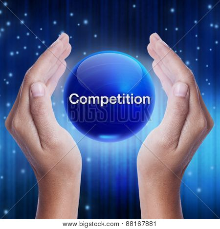 Hand showing blue crystal ball with competition word.