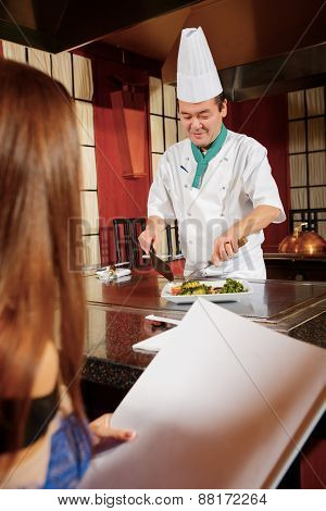 Client examines restaurant menu
