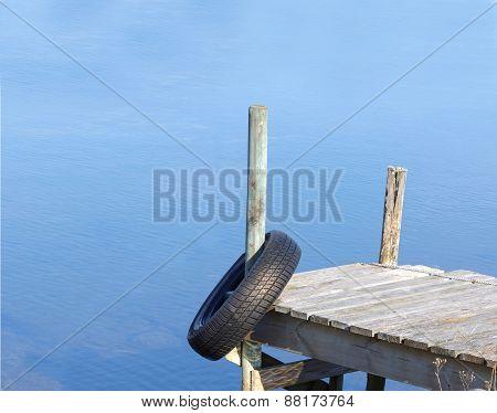 Silhouette of tiny bridge and tyre