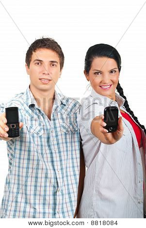 Cheerful Couple Offering Phones Mobile