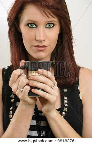 Beautiful Female With Green Eyes Drinking Coffee