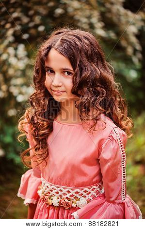 summer vertical portrait of happy child girl in pink fairytale princess dress