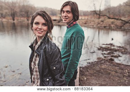 young happy loving couple on the walk in early spring