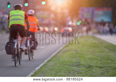 Two Cyclists In A Busy Part Of The Town