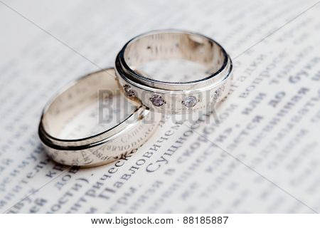 wedding rings on the book