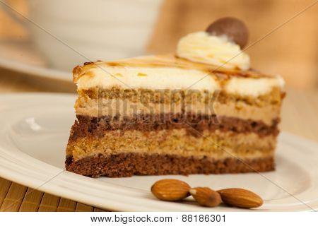 Deliceous Slice Og Caramel Mousse Cake On A Plate  Closeup Photo