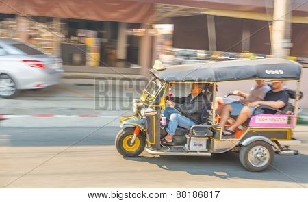Blur Image Of Unidentified Driver And Tourists In Tuk-tuk Vehicle