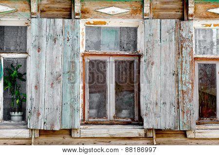 Closeup of old rural slum  house windows in Astrakhan, Russia