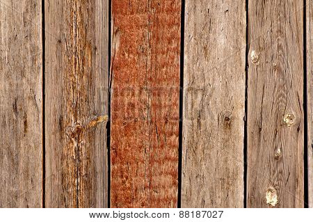 Wooden background with one painted in brown plank