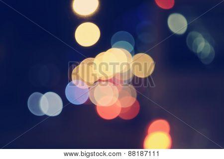 Lights blurred bokeh background night street for your design, instagram vintage retro color tone, co