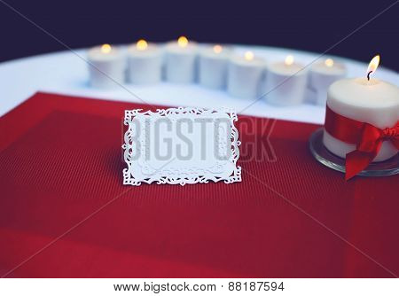 Paper Card For A Text On Decorated Table With Burning Candles. Wedding, Banquet, Holiday Background