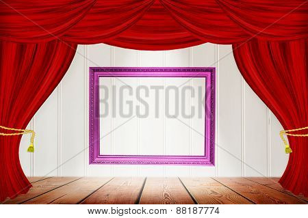Frame On The Background Of  Red Curtains On  Wood Wall.